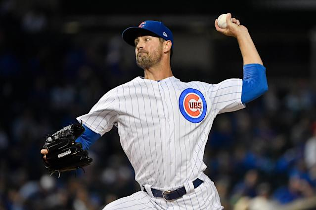 CHICAGO, ILLINOIS - SEPTEMBER 16: Starting pitcher Cole Hamels #35 of the Chicago Cubs delivers the ball in the first inning against the Cincinnati Reds at Wrigley Field on September 16, 2019 in Chicago, Illinois. (Quinn Harris/Getty Images)