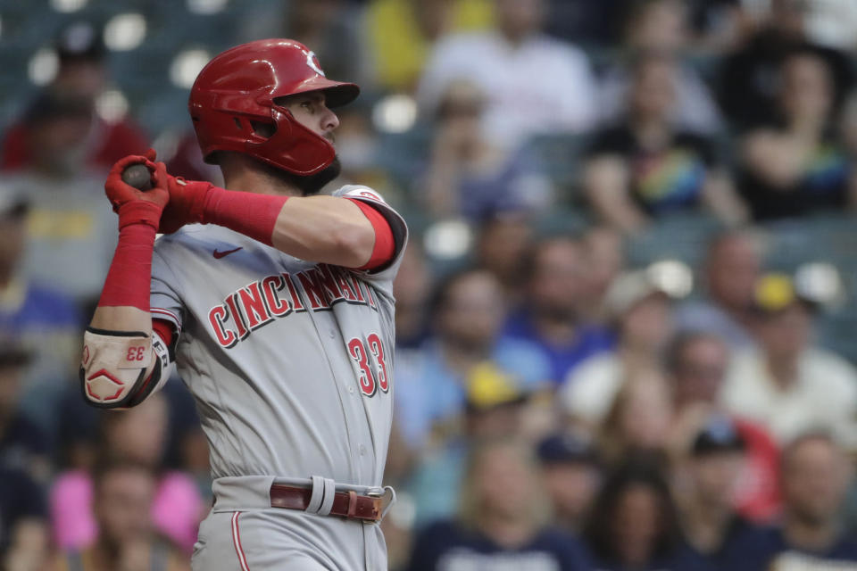 Cincinnati Reds' Jesse Winker hits an RBI-single during the second inning of a baseball game against the Milwaukee Brewers, Monday, June 14, 2021, in Milwaukee. (AP Photo/Aaron Gash)