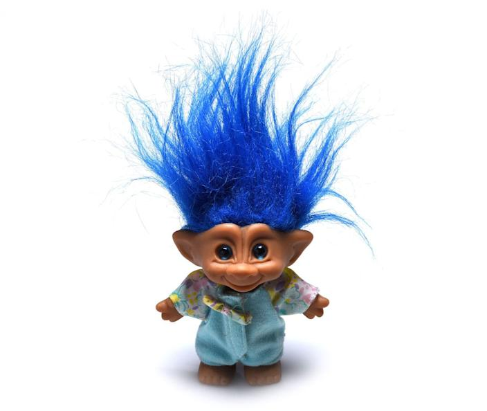 <p>Troll dolls were everything back in the day, and you couldn't have just one. A major downside: It was hard AF to brush their hair.</p>