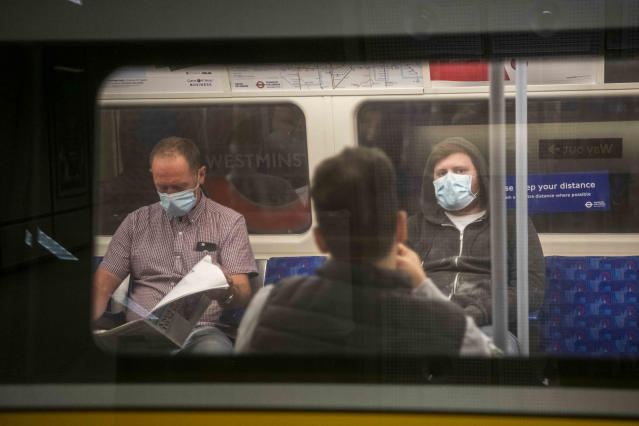 Commuters were face masks on public transport as lockdown eases and infections continue to fall. (PA Images)