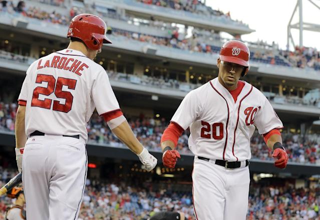Washington Nationals' Ian Desmond (20) celebrates his solo home run with Adam LaRoche (25) during the second inning of a baseball game against the San Francisco Giants at Nationals Park Wednesday, Aug. 14, 2013, in Washington. (AP Photo/Alex Brandon)