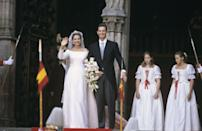 <p>Infanta Cristina exchanged vows to Inaki Urdangarin, a professional handball team player, in a custom off-the-shoulder gown by Spanish label Lorenzo Caprile. </p>