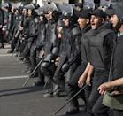 Egyptian riot policemen march towards Cairo University on March 19, 2014 as clashes break out during a protest by Muslim Brotherhood students