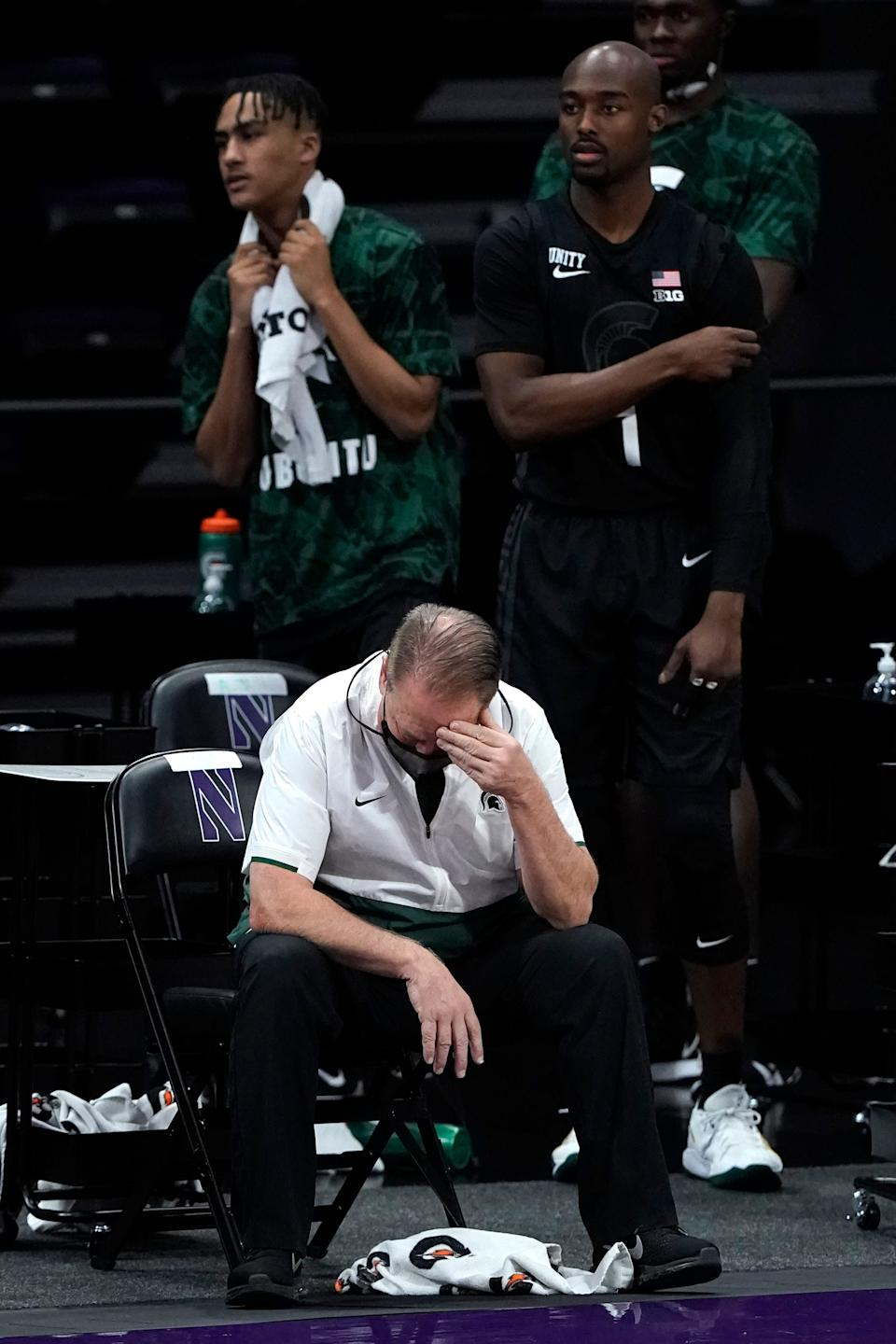 Michigan State head coach Tom Izzo, bottom, reacts during the second half of an NCAA college basketball game against Northwestern in Evanston, Ill., Sunday, Dec. 20, 2020. Northwestern won 79-65.