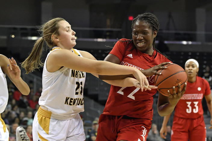 Northern Kentucky guard Ally Niece (25) battles Louisville forward Elizabeth Dixon (22) for the ball during the first half of an NCAA college basketball game in Highland Heights, Ky., Sunday, Dec. 8, 2019. (AP Photo/Timothy D. Easley)