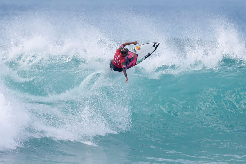 With Olympics, world champ says surfing shreds image as sport for 'bums'