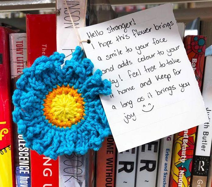 The flowers were left alongside notes, hoping to brighten a stranger's day. Source: Brisbane Libraries