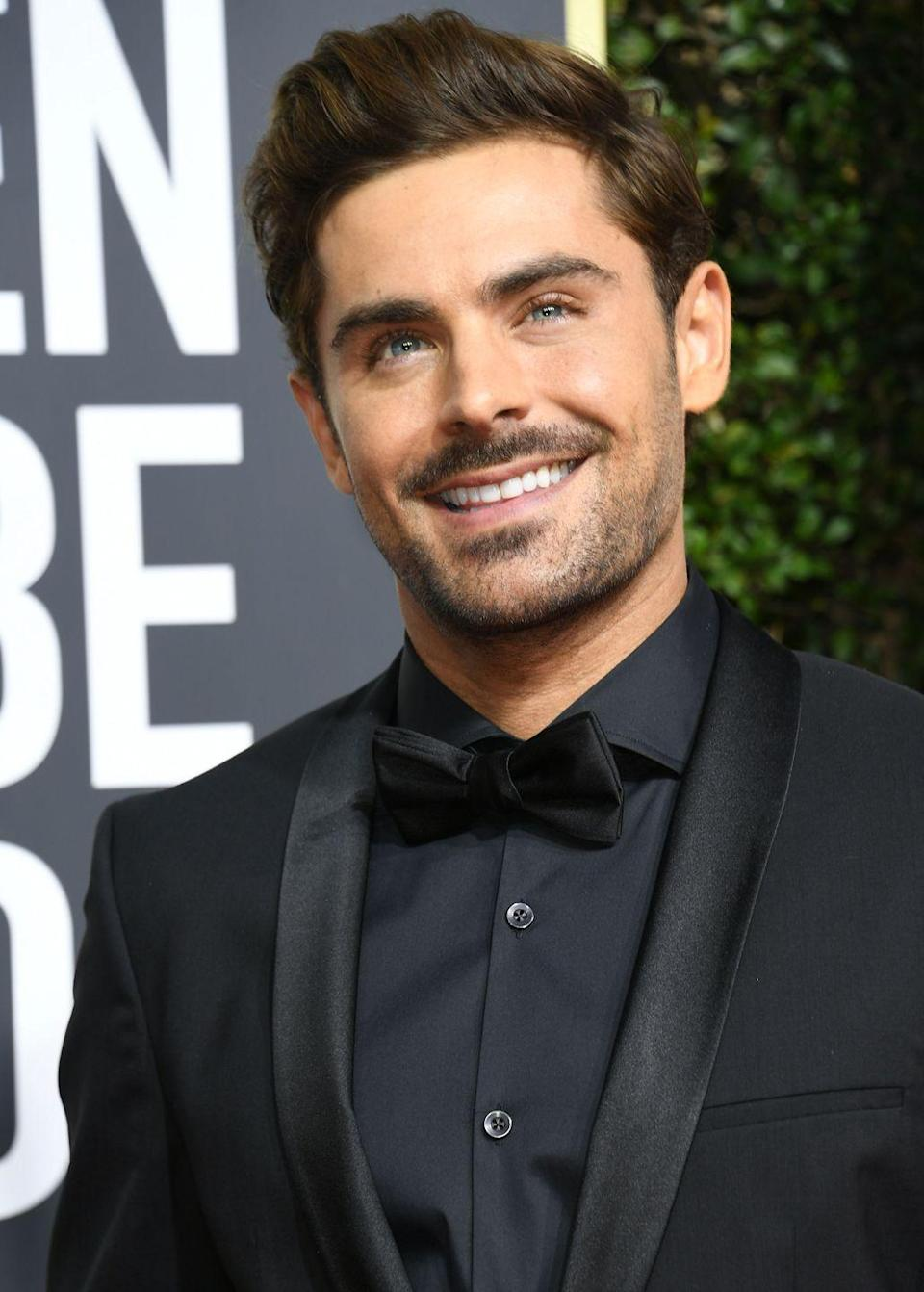 <p>Recently, Efron has been serving up lots of scruff on the red carpet, which makes him appear older.</p>