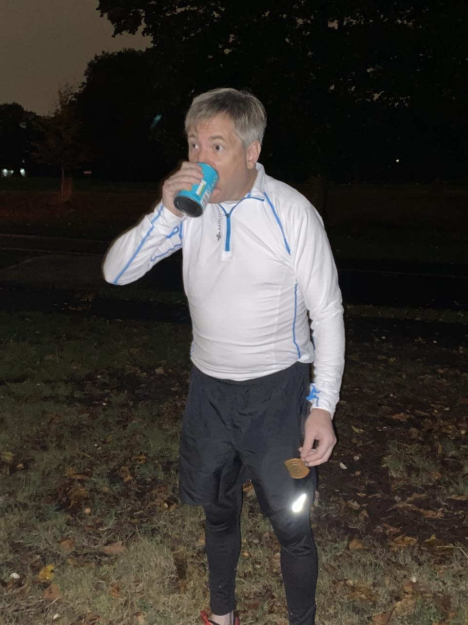 Michael Ferndale downs a tin of cold baked beans on day one of his five backwards marathons in five days