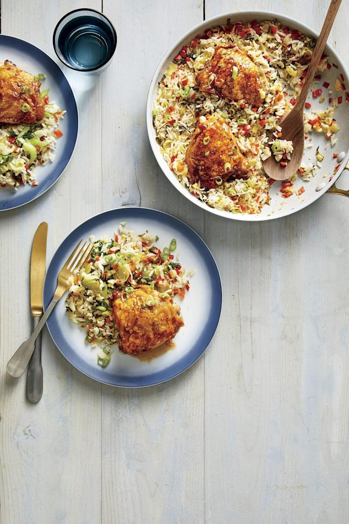 """<p><strong>Recipe: <a href=""""https://www.southernliving.com/recipes/hot-honey-chicken-rice"""" rel=""""nofollow noopener"""" target=""""_blank"""" data-ylk=""""slk:One-Pan Hot Honey Chicken and Rice"""" class=""""link rapid-noclick-resp"""">One-Pan Hot Honey Chicken and Rice</a></strong></p> <p>This budget-friendly supper feeds the whole family in 45 minutes. If you have leftover rice, make better-than-takeout fried rice the next night for dinner.</p>"""