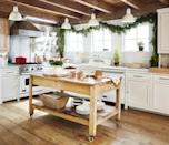 """<p>Fresh pine-and-cedar garland and an antique Santa pop in this all-white kitchen. The island doubles as a wrapping station. </p><p><a class=""""link rapid-noclick-resp"""" href=""""https://www.amazon.com/slp/decorative-garland/njqpwobgftvd7ed?tag=syn-yahoo-20&ascsubtag=%5Bartid%7C10050.g.1247%5Bsrc%7Cyahoo-us"""" rel=""""nofollow noopener"""" target=""""_blank"""" data-ylk=""""slk:SHOP GARLAND"""">SHOP GARLAND</a></p>"""
