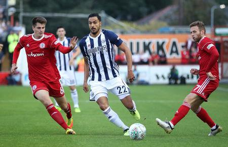 Soccer Football - Carabao Cup Second Round - Accrington Stanley vs West Bromwich  - Accrington, Britain - August 22, 2017   West Bromwich Albion's Nacer Chadli in action with Accrington Stanley's Liam Nolan (L)   Action Images via Reuters/John Clifton