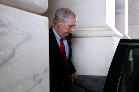 FILE PHOTO: U.S. Senate Majority Leader Mitch McConnell (R-KY) departs the Capitol to go to the White House to meet with U.S. President Donald Trump, as members of the legislative branch faced deadlines for a potential federal government shutdown, in Washington, U.S. December 21, 2018. REUTERS/Jonathan Ernst/File Photo