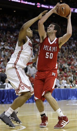 Miami (Ohio)'s Drew McGhee, right, shoots over Ohio State's Jared Sullinger during the first half of an NCAA college basketball game Thursday, Dec. 22, 2011, in Columbus, Ohio. (AP Photo/Jay LaPrete)