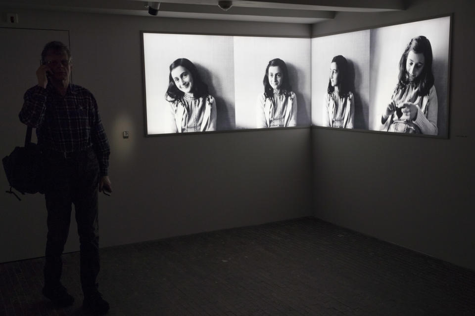 A journalist takes the audio tour of the renovated Anne Frank House Museum in Amsterdam, Netherlands, Wednesday, Nov. 21, 2018. The museum is built around the secret annex hidden in an Amsterdam canal-side house where teenage Jewish diarist Anne Frank hid from Nazi occupiers during World War II is expanding to better tell Anne's tragic story to the growing number of visitors. (AP Photo/Peter Dejong)