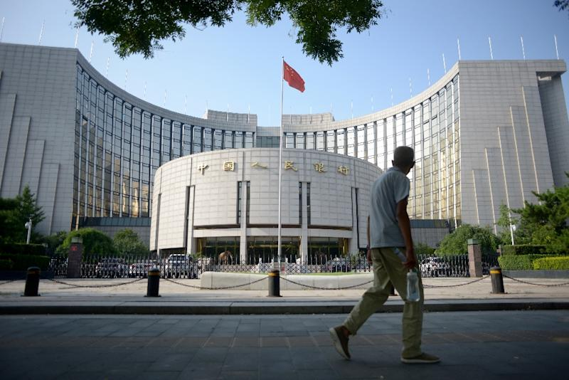 The People's Bank of China has cut interest rates six times since late 2014 and has also lowered the proportion of reserves that banks must set aside, in an effort to boost lending and revitalise the flagging economy (AFP Photo/Wang Zhao)