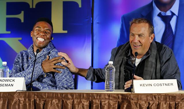 "Actors Chadwick Boseman, left, and Kevin Costner appear at a news conference for the movie ""Draft Day"" in New York on Friday, Jan. 31, 2014, two days before the NFL football Super Bowl in East Rutherford, N.J. (AP Photo/Paul Sancya)"