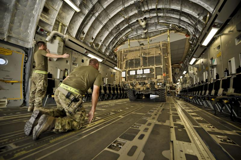 An eight wheeled combat heavy lifting truck, complete with bar-armour, is reversed and loaded onto a C-17 aircraft on the runway at Camp Bastion, Helmand Province, Afghanistan, where it will return back to the UK as part of equipment redeployment from theatre as the drawdown progresses ready for total withdrawal of UK forces in 2014.