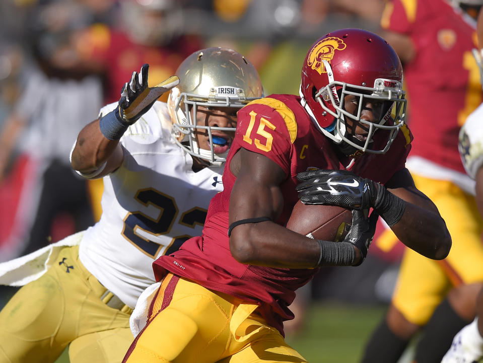 Southern California wide receiver Nelson Agholor, right, runs in for a touchdown as Notre Dame safety Elijah Shumate attempts to tackle him during the first half of an NCAA college football game, Saturday, Nov. 29, 2014, in Los Angeles. (AP Photo/Mark J. Terrill)