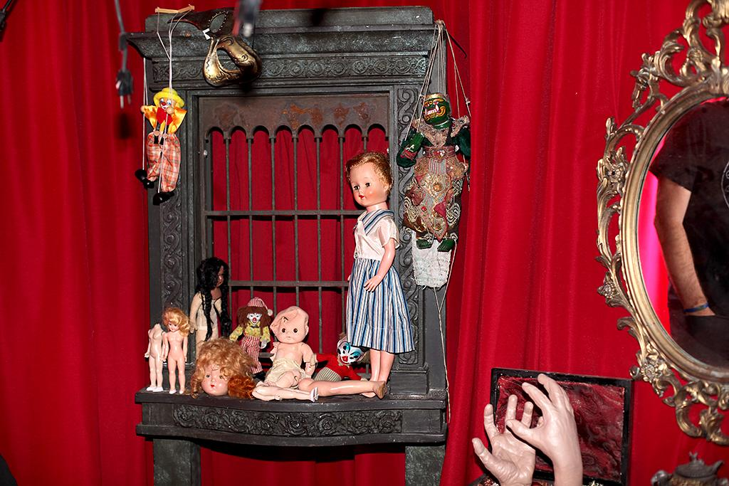 <p><em>Insidious</em> fans will recognize this red room as the demon's lair from the first movie. The room is covered in frightening dolls and various trinkets matching that of the film's. (Photo: Camilo Urdaneta/Yahoo) </p>
