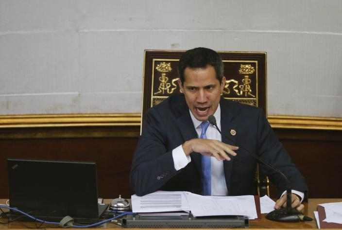 FILE - In this Sept. 17, 2019 file photo, Venezuelan opposition leader and self-proclaimed interim president of Venezuela Juan Guaido speaks during a weekly session at the National Assembly in Caracas, Venezuela. The United States and more than a dozen Latin American countries are meeting Monday, Sept. 23 to consider multilateral sanctions against Venezuela. The foreign ministers are expected to discuss a range of punishments, including loss of diplomatic recognition and an economic boycott. Many of the participating countries recognize Guaidó as Venezuela's legitimate leader after he declared himself interim president in January, citing what was seen as President Nicolás Maduro's fraudulent re-election last year. (AP Photo/Ariana Cubillos, File)
