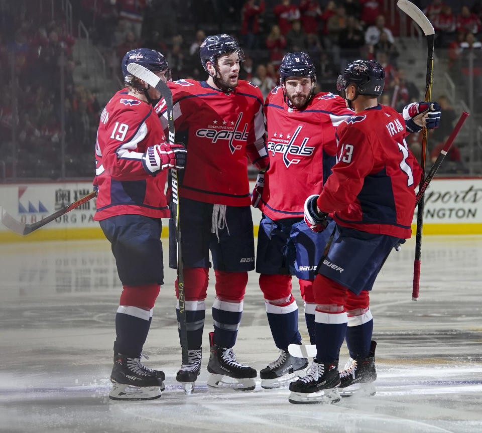 Washington Capitals right wing Tom Wilson, second from left, celebrates his goal against the Ottawa Senators with teammates Nicklas Backstrom (19), Michal Kempny and Jakub Vrana (13) during the second period of an NHL hockey game Tuesday, Feb. 27, 2018, in Washington. (AP Photo/Pablo Martinez Monsivais)
