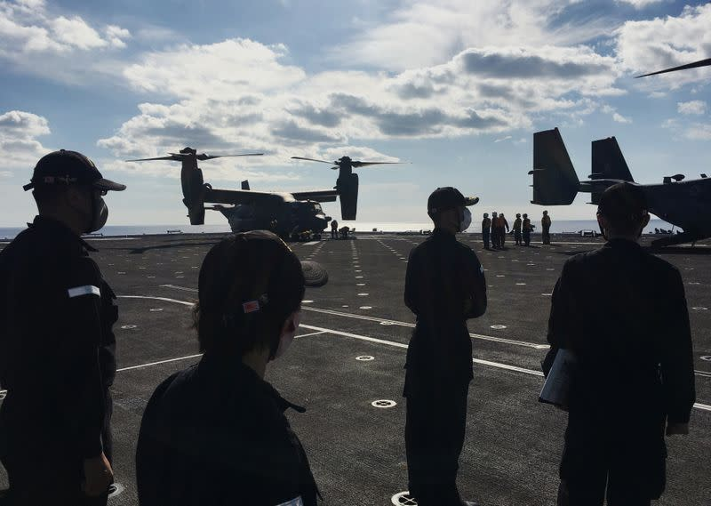 Japan Maritime Self-Defense Force soldiers watch U.S. MV-22 Osprey aircrafts on board of the helicopter destroyer JS Kaga during Keen Sword, at mid-sea off south of Japan