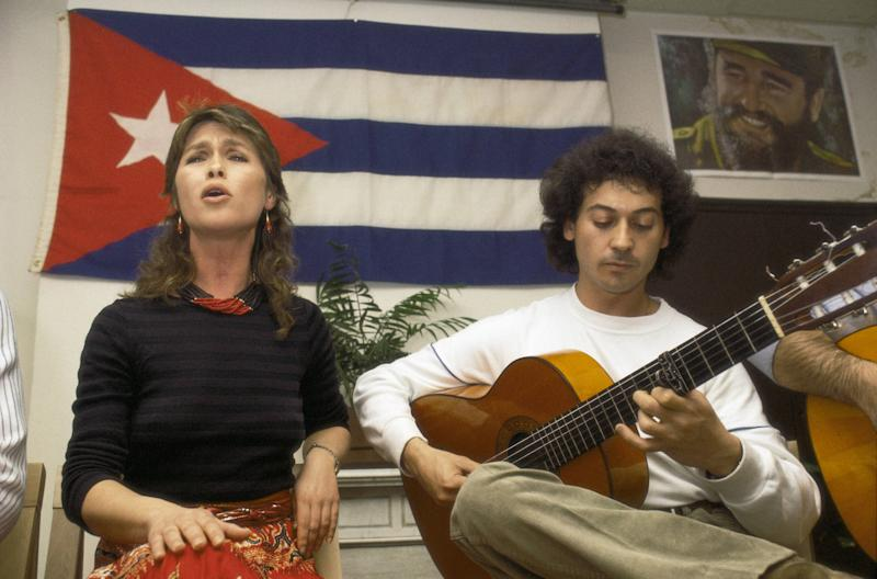 Pepa Flores, Marisol, in a pro-Cuba act The actress singing with a guitar player (Photo by Quim Llenas/Cover/Getty Images)