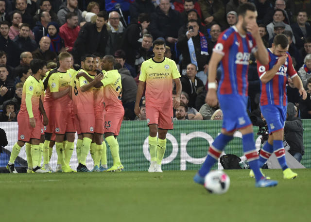 Manchester City's Gabriel Jesus celebrates with teammates the his side opening goal during the English Premier League soccer match between Crystal Palace and Manchester City at Selhurst Park in London, England, Saturday, Oct. 19, 2019. (AP Photo/Rui Vieira)