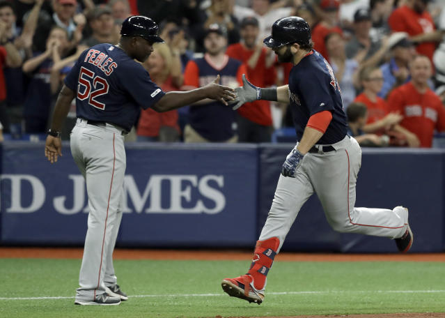 Boston Red Sox's Mitch Moreland, right, celebrates his home run off Tampa Bay Rays relief pitcher Diego Castillo with third base coach Carlos Febles (52) during the eighth inning of a baseball game Friday, April 19, 2019, in St. Petersburg, Fla. (AP Photo/Chris O'Meara)