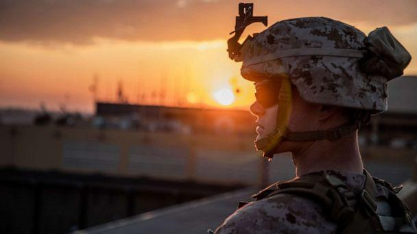 PHOTO: A U.S. Marine with 2nd Battalion, 7th Marines, assigned to the Special Purpose Marine Air-Ground Task Force-Crisis Response-Central Command 19.2, stands post during the reinforcement of the Baghdad Embassy Compound in Iraq, Jan. 4, 2020. (Sgt. Kyle Talbot/US Marine Corps)
