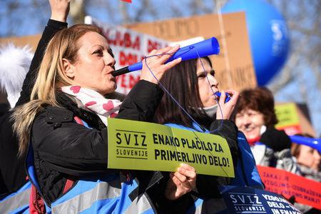 Protesters blow horns during teachers' demonstration for higher wages in Ljubljana