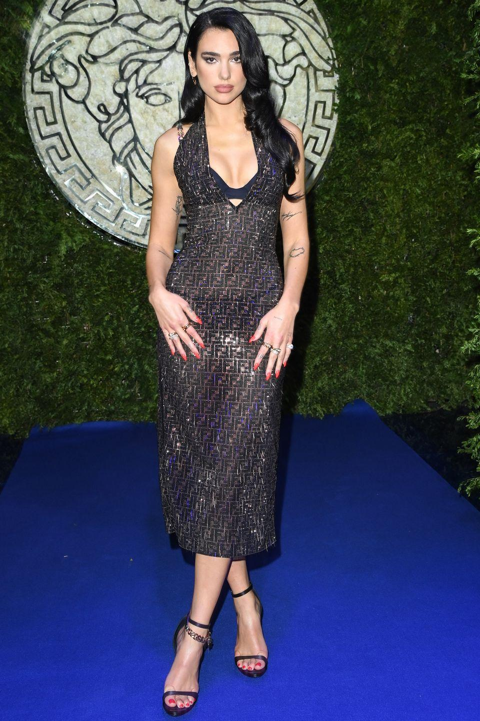 """<p><strong>26 September </strong></p><p>Dua Lipa wore a sheer black dress and strappy heels to attend the special <a href=""""https://www.harpersbazaar.com/uk/fashion/shows-trends/a37749500/versace-fendi-fendace-show/"""" rel=""""nofollow noopener"""" target=""""_blank"""" data-ylk=""""slk:Versace x Fendi collaboration show"""" class=""""link rapid-noclick-resp"""">Versace x Fendi collaboration show</a>. </p>"""