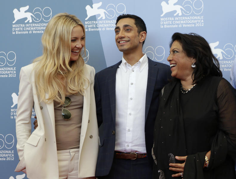 From left, actress Kate Hudson, actor Riz Ahmed, and director Mira Nair pose during the photo call for the movie 'The reluctant Fundamentalist' at the 69th edition of the Venice Film Festival in Venice, Italy, Wednesday, Aug. 29, 2012. (AP Photo/Andrew Medichini)