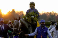 Jockey Luis Saez and Essential Quality are led to the winner's circle after winning the Breeders' Cup Juvenile horse race at Keeneland Race Course, Friday, Nov. 6, 2020, in Lexington, Ky. (AP Photo/Michael Conroy)