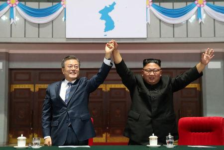 "South Korean President Moon Jae-in and North Korean leader Kim Jong Un acknowledges the audience after watching the performance titled ""The Glorious Country""  at the May Day Stadium in Pyongyang"