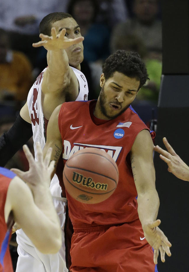 Dayton forward Devin Oliver (5) works against Stanford forward Dwight Powell (33) during the second half in a regional semifinal game at the NCAA college basketball tournament, Thursday, March 27, 2014, in Memphis, Tenn. (AP Photo/Mark Humphrey)