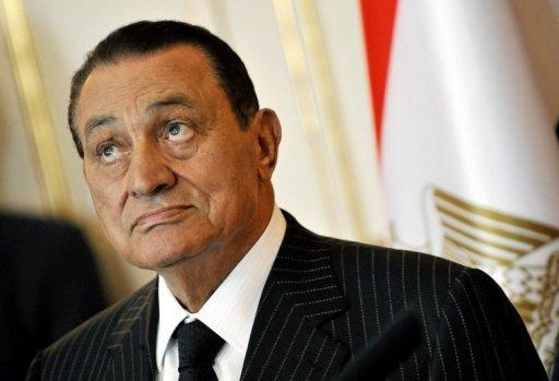 Egypt's ex-president Hosni Mubarak, pictured in 2009, was declared clinically dead after he was transferred to hospital from prison on Tuesday, state media reported, but a medical source said he was in a coma