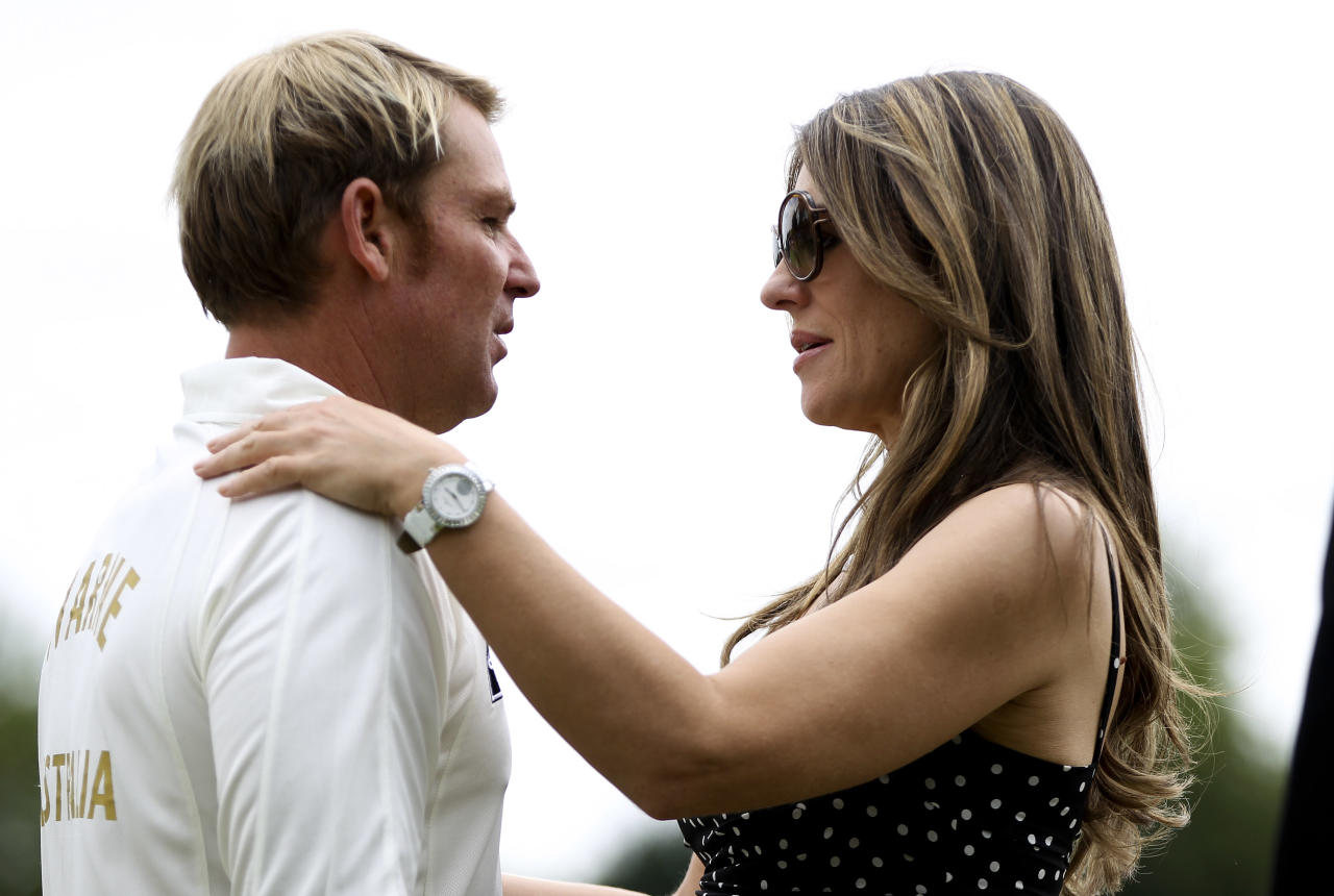 CIRENCESTER, ENGLAND - JUNE 09: Shane Warne and Elizabeth Hurley look on prior to Shane Warne's Australia vs Michael Vaughan's England T20 match at Cirencester Cricket Club on June 09, 2013 in Cirencester, England. (Photo by Ben Hoskins/Getty Images)