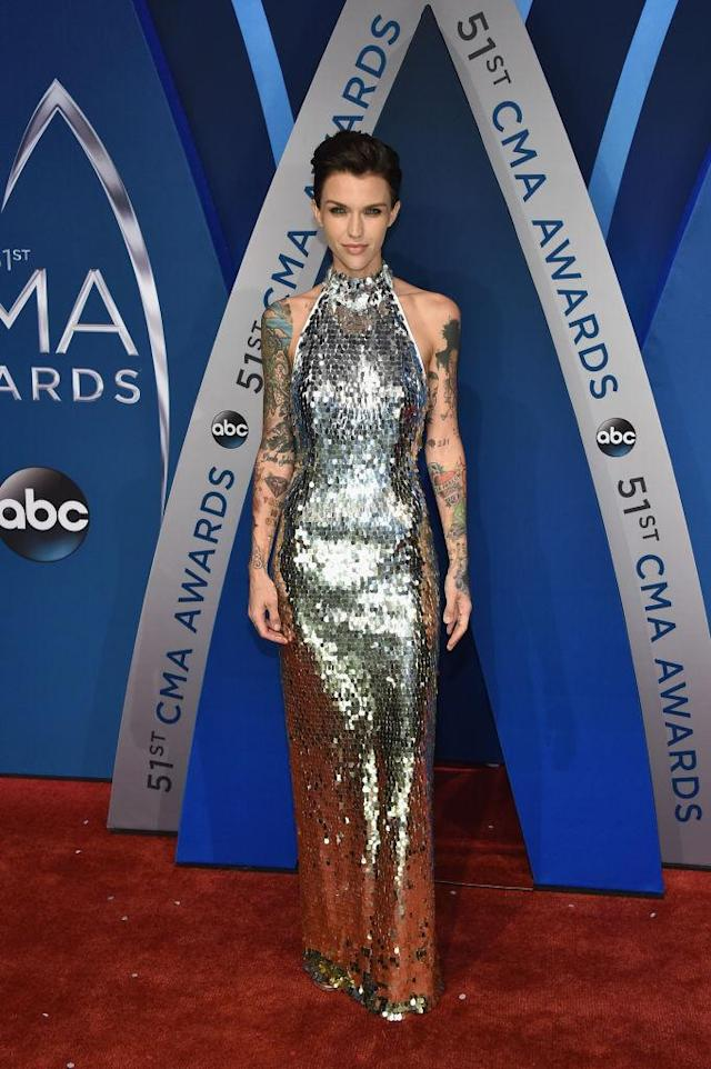 <p>The actress sticks to her edgy roots in a sparkling metallic halter dress. (Photo: Getty Images) </p>