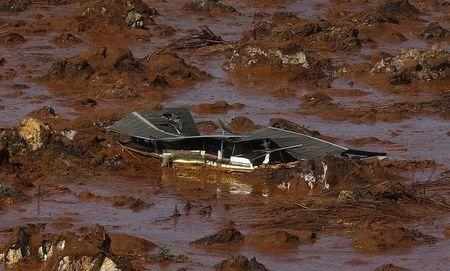 Debris of a house is pictured at Bento Rodrigues district, which was covered with mud after a dam owned by Vale SA and BHP Billiton Ltd burst in Mariana, Brazil, November 6, 2015. REUTERS/Ricardo Moraes