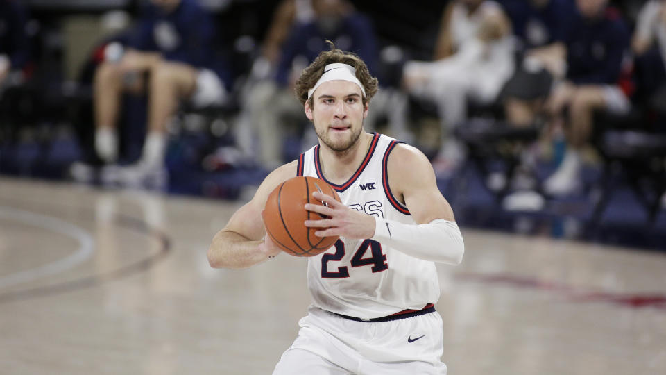 Gonzaga forward Corey Kispert prepares to pass the ball during the first half of an NCAA college basketball game against Loyola Marymount in Spokane, Wash., Saturday, Feb. 27, 2021. (AP Photo/Young Kwak)