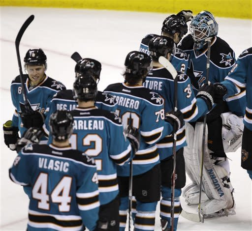 San Jose Sharks players line up to congratulate goalie Antti Niemi (31) after their game against the Columbus Blue Jackets in an NHL hockey game in San Jose, Calif., Tuesday, Jan. 31, 2012. The Sharks defeated the Blue Jackets 6-0. (AP Photo/Paul Sakuma)