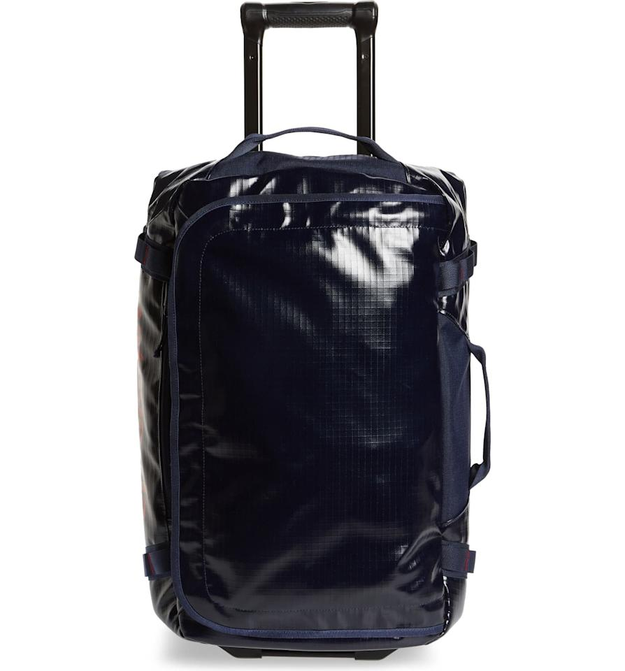 "<p>This <a href=""https://www.popsugar.com/buy/Patagonia-Black-Hole-40-Liter-Rolling-Duffle-Bag-538700?p_name=Patagonia%20Black%20Hole%2040-Liter%20Rolling%20Duffle%20Bag&retailer=shop.nordstrom.com&pid=538700&price=299&evar1=fab%3Aus&evar9=45654068&evar98=https%3A%2F%2Fwww.popsugar.com%2Fphoto-gallery%2F45654068%2Fimage%2F47089844%2FPatagonia-Black-Hole-40-Liter-Rolling-Duffle-Bag&list1=shopping%2Ctravel%2Cbags%2Cluggage%2Csuitcases%2Ctravel%20style%2Cbest%20of%202020&prop13=api&pdata=1"" rel=""nofollow"" data-shoppable-link=""1"" target=""_blank"" class=""ga-track"" data-ga-category=""Related"" data-ga-label=""https://shop.nordstrom.com/s/patagonia-black-hole-40-liter-rolling-duffle-bag/5245570/full?origin=keywordsearch-personalizedsort&amp;breadcrumb=Home%2FAll%20Results&amp;color=classic%20navy"" data-ga-action=""In-Line Links"">Patagonia Black Hole 40-Liter Rolling Duffle Bag</a> ($299) is super strong and water resistant, so basically, sign us up.</p>"