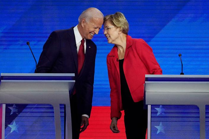 Former Vice President Joe Biden, left and Sen. Elizabeth Warren, D-Mass., talk Thursday, Sept. 12, 2019, during a Democratic presidential primary debate hosted by ABC at Texas Southern University in Houston.