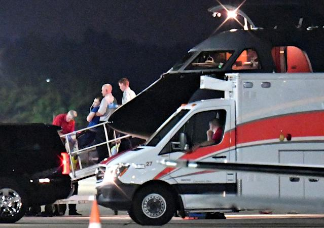 <p>A person believed to be Otto Warmbier is transferred from a medical transport airplane to an awaiting ambulance at Lunken Airport in Cincinnati, Ohio, June 13, 2017. (Photo: Bryan Woolston/Reuters) </p>