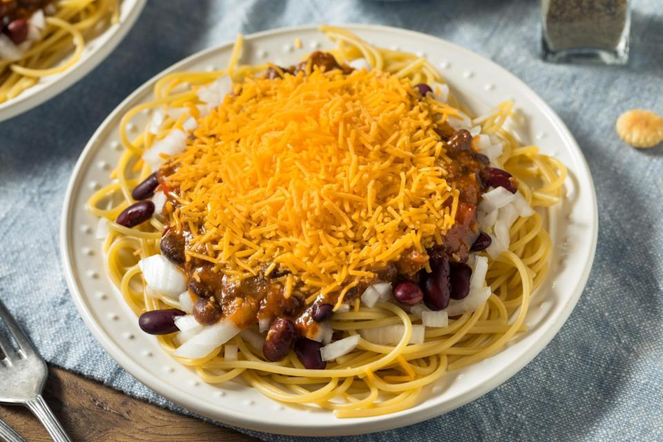 """<p>Cincinnati chili — that no-bean, sweet ground beef concoction, piled on top of spaghetti and served with ample amounts of cheddar cheese — is often misunderstood. But don't knock it till you try it. It's one of <a href=""""https://www.thedailymeal.com/eat/regional-american-chili-styles?referrer=yahoo&category=beauty_food&include_utm=1&utm_medium=referral&utm_source=yahoo&utm_campaign=feed"""" rel=""""nofollow noopener"""" target=""""_blank"""" data-ylk=""""slk:the most famous regional chilis in America"""" class=""""link rapid-noclick-resp"""">the most famous regional chilis in America</a> for a reason.</p> <p><a href=""""https://www.thedailymeal.com/best-recipes/copycat-cincinnati-chili?referrer=yahoo&category=beauty_food&include_utm=1&utm_medium=referral&utm_source=yahoo&utm_campaign=feed"""" rel=""""nofollow noopener"""" target=""""_blank"""" data-ylk=""""slk:For the Cincinnati Chili recipe, click here."""" class=""""link rapid-noclick-resp"""">For the Cincinnati Chili recipe, click here.</a></p>"""