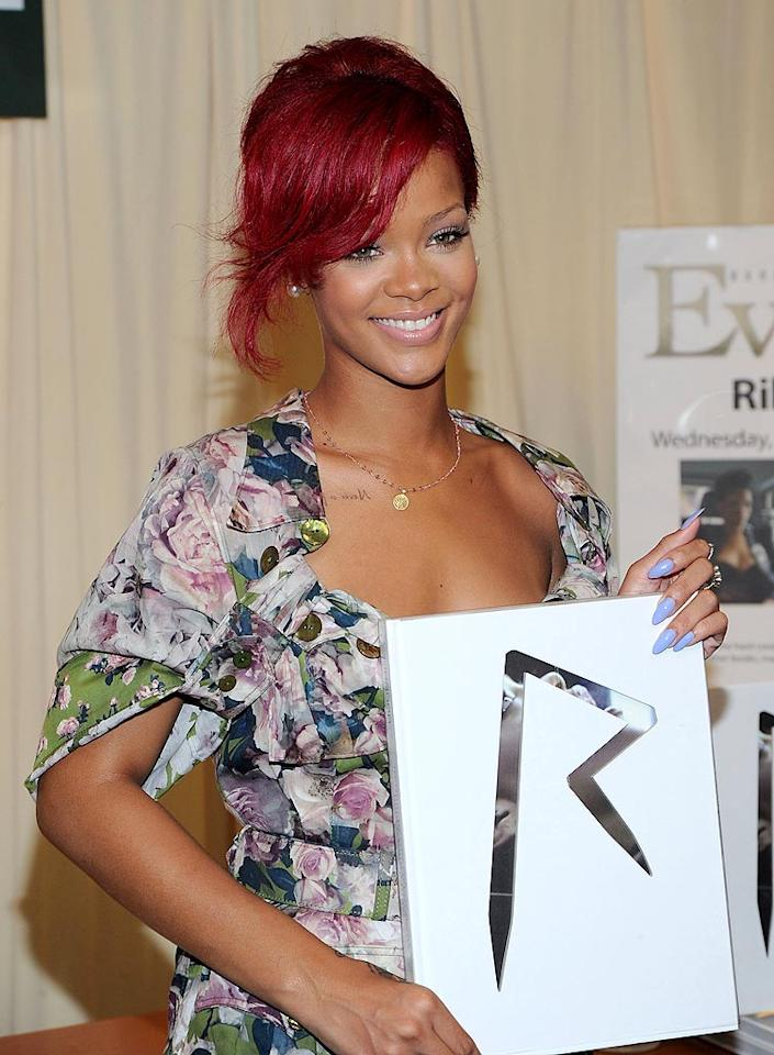 """Sporting a floral Jean Paul Gaultier dress, Rihanna showed off some very scary purple fingernails and a slightly darker 'do Wednesday when she signed copies of her new book, <i>Rihanna</i>, in NYC. The glossy tome features a collection of photos from Rihanna's """"Last Girl on Earth"""" world tour. Jason Kempin/<a href=""""http://www.gettyimages.com/"""" target=""""new"""">GettyImages.com</a> - October 27, 2010"""