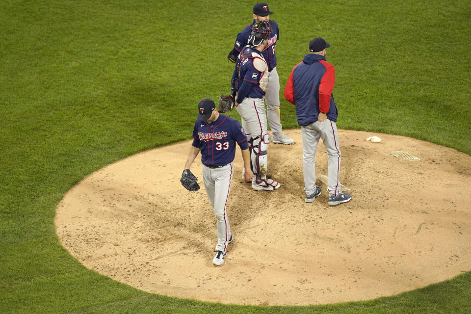 Minnesota Twins starting pitcher J.A. Happ (33) walks off the mound after being relieved by manager Rocco Baldelli during the fourth inning of a baseball game against the Chicago White Sox Wednesday, May 12, 2021, in Chicago. (AP Photo/Charles Rex Arbogast)