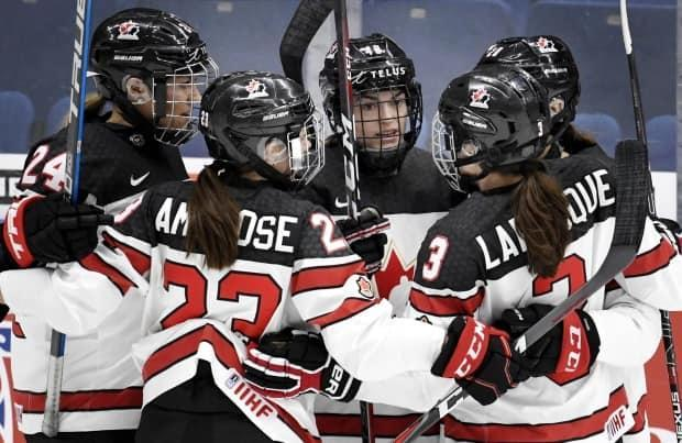 From left to right: Natalie Spooner, Erin Ambrose, Blayre Turnbull, Jocelyne Larocque and Sarah Nurse of Canada celebrate a goal during the 2019 IIHF women's world championship tournament. All have been named to the centralization roster to try out for the 2022 team.